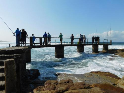 Fishing from the old pier at St Michaels-on-Sea, KwaZulu-Natal South Coast